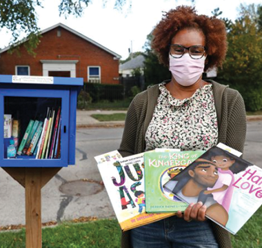 She's a teacher out to create little free children's libraries — full of books that go beyond white kids and animals